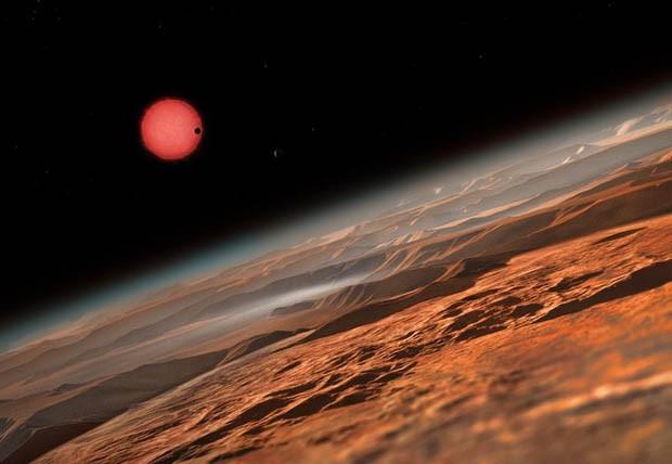 Ilustração da vista imaginada próximo à superfície de um dos três planetas que orbitam uma estrela anã. (Foto: ESO/M. Kornmesser)