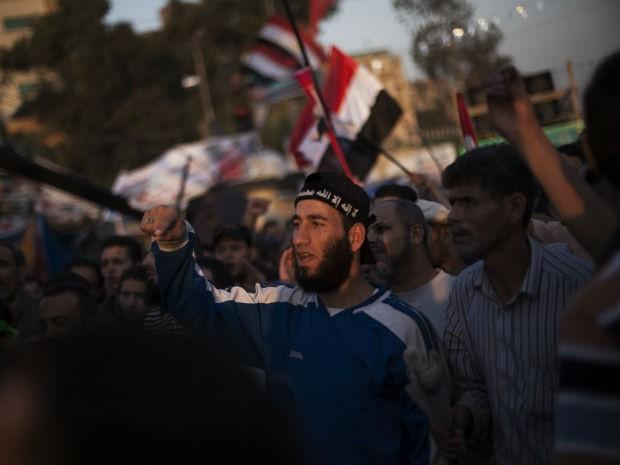 Morsi foi destituído em julho pelo Exército e está detido em lugar secreto (Foto: Manu Brabo/AP)
