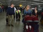 Luciano Huck e Angélica desembarcam com os filhos em São Paulo