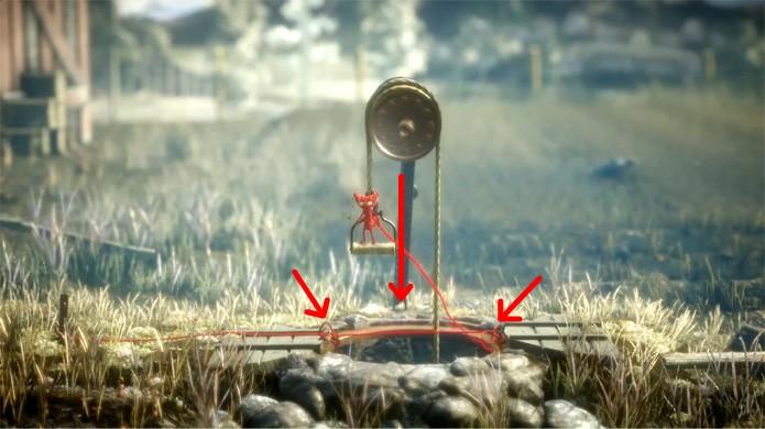 Use novamente o trampolim de Unravel no meio do poço e agarre-se na alça para puxar um balde (Foto: Reprodução/Rafael Monteiro)