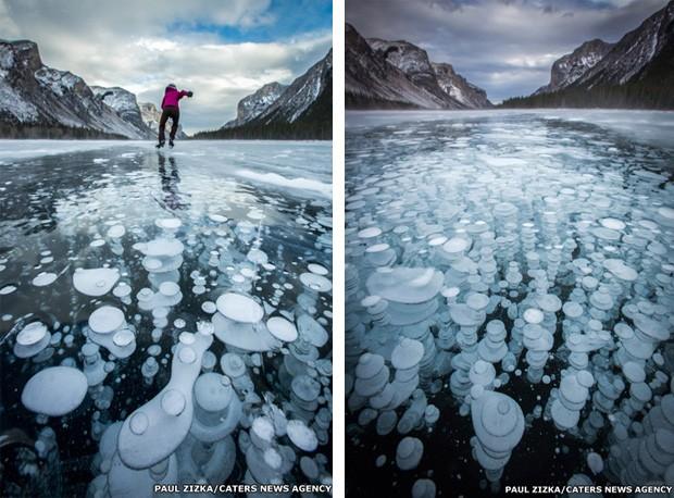 Gelo formado por gás metano em lago congelado no Canadá (Foto: Paul Zizka/Caters News)