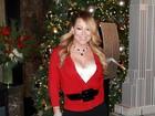 Mariah Carey, decotada, vai com o novo namorado a evento nos EUA