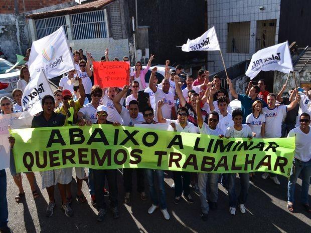 'Abaixa a liminar, queremos trabalhar', pedem os divulgadores. (Foto: Fredson Navarro / G1)