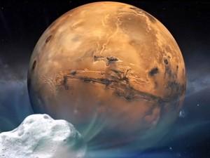 Ilustração mostra o cometa Siding Spring e o planeta Marte, em imagem divulgada pela Nasa. Após viajar bilhões de quilômetros, o cometa proveniente da Nuvem de Oort passará a 140 mil km de Marte, apenas um terço da distância entre a Terra e a Lua (Foto: AFP/Nasa)