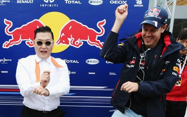 Rapper PSY e Sebastian Vettel no GP da Coreia do Sul (Foto: Getty Images)