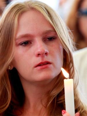 Velas acesas lembraram vítimas do incêndio (Foto: Wesley Santos/Estadão Conteúdo)