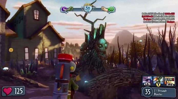 Árvore com rosto de zumbi indica a direção da floresta (Foto: Reprodução: YouTube)