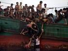 Milhares de imigrantes abandonados  seguem à deriva no sudeste da Ásia