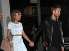 De top e saia, Taylor Swift curte jantar romântico com Calvin Harris