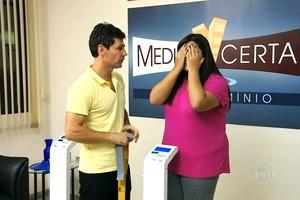 Moradores encaram balança  após um mês e meio de treinos (TV Globo)