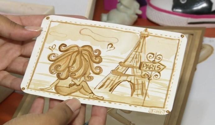 Suzanense utiliza a pigmentação do café para pintar cartões postais (Foto: Reprodução / TV Diário)