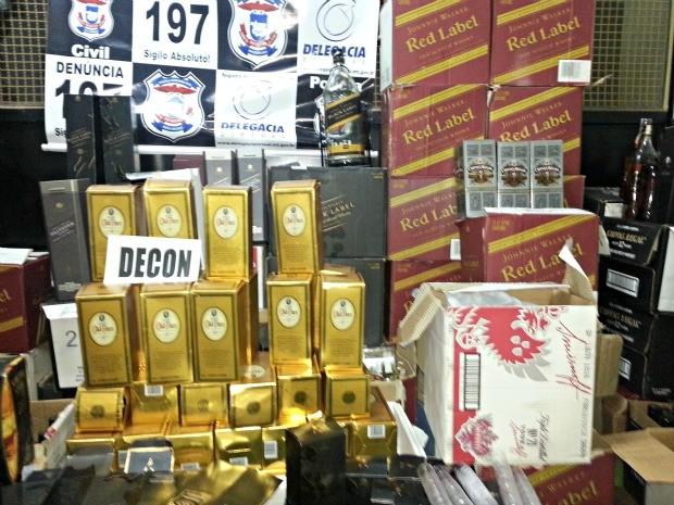 Uísque falsificado foi apreendido pela Delegacia do Consumidor (Foto: Assessoria/ Polícia Civil - MT)