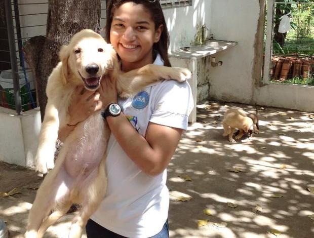 Sarah Menezes e seus cachorros (Foto: Reprodução/ Facebook)