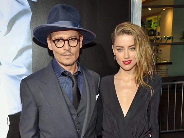 Johnny Depp e a atriz Amber Heard na pré-estreia do filme '3 Days to Kill' em fevereiro deste ano, em Los Angeles (Foto: John Shearer/Invision/AP)