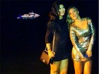 Ex-BBB Marien Carretero posa em Búzios com iate de DiCaprio ao fundo