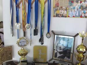 Medalhas e troféus de campeonatos de xadrez (Foto: Mariane Rossi/G1)