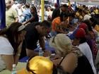 Venezuelanos denunciam demissões por assinarem referendo revogatório