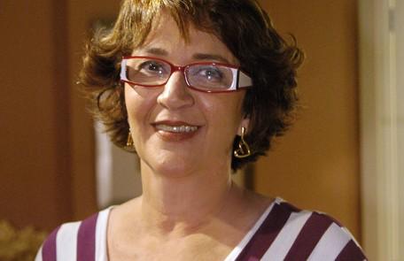 """Val (Rosane Gofman) era a secretária apaixonada pelo chefe, Ramiro (Humberto Martins). Vivia dizendo: """"Jesus, me abana"""" TV Globo"""