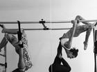 Isis Valverde fica de cabeça pra baixo em aula de pilates