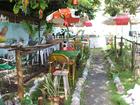 Debaixo de cajueiro plantado por mãe, casa vira restaurante em MS