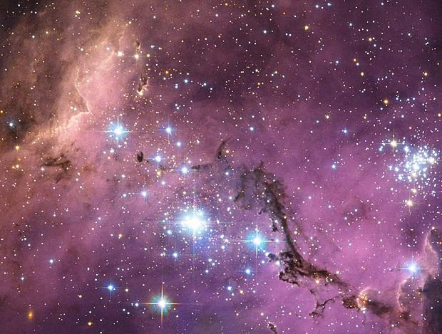 Hubble observou nuvens de poeira que se chocam e formam estrelas na Grande Nuvem de Magalhães (Foto: ESA/NASA/Hubble)