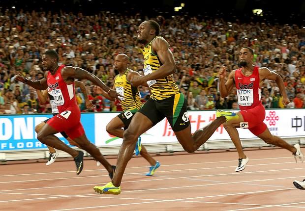 Usain Bolt cruza linha de chegada na prova dos 100 metros no Campeonato Mundial em Pequim, em 2015 (Foto:  Andy Lyons/Getty Images)