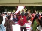 Manifestantes marcham e fazem ato por terra em frente à Terracap