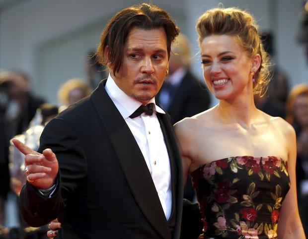 Amber Heard e Johnny Depp (Foto: AFP)