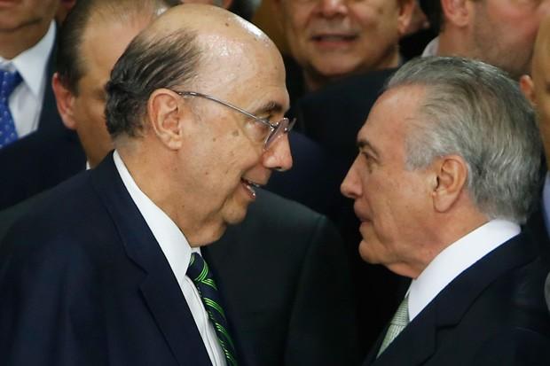 Henrique Meirelles e Michel Temer (Foto: Igo Estrela/Getty Images)