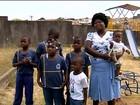 Haitiana comemora reencontro com filhos após três anos no Brasil