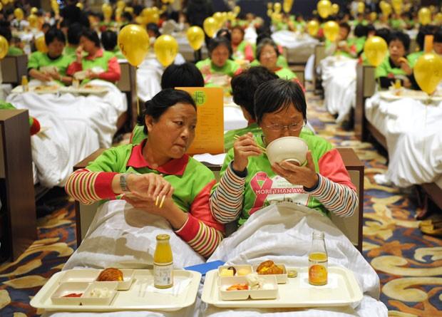 Tentativa bem sucedida foi realizada em um hotel em Xangai (Foto: Jia Ru/AFP)
