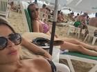 Cacau Colucci mostra barriga sequinha em dia de praia