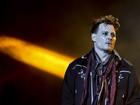 Johnny Depp, acusado por Amber Heard de agressão, faz show