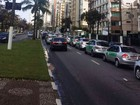Taxistas fazem buzinaço pedindo fiscalização contra Uber em Santos