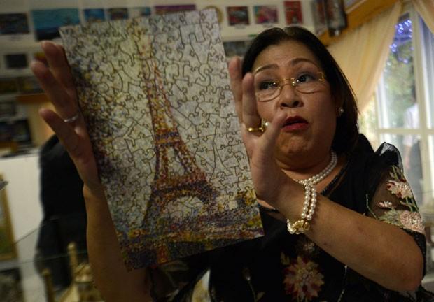 Georgina Gil-Lacuna conta com 1.030 quebra-cabeças. (Foto: Ted Aljibe/AFP)