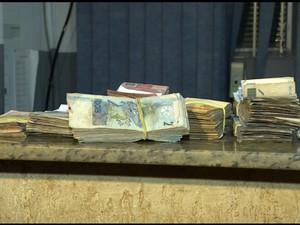 Dinheiro apreendido pela PM (Foto: Reprodução/EPTV)