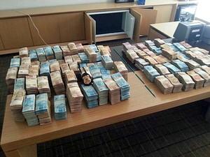 Dinheiro apreendido pela PF na 16ª fase da Operação Lava Jato (Foto: Reprodução / PF)