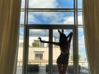 Izabel Goulart posa como coelhinha sexy com transparência e orelhinhas