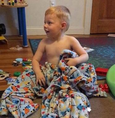 Parker com os dois novos cobertores (Foto: Reprodução)
