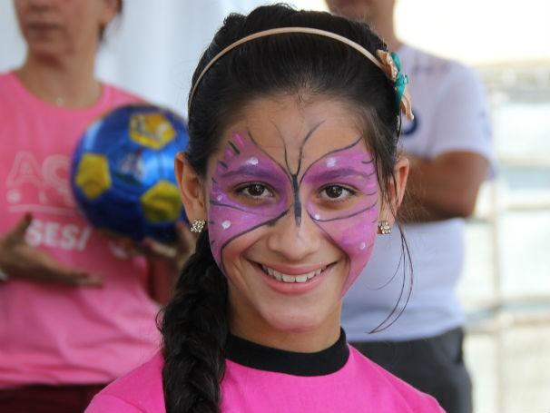 Criança se diverte na Ação Global em Belford Roxo (Foto: Divulgação/Alessandra de Paula)