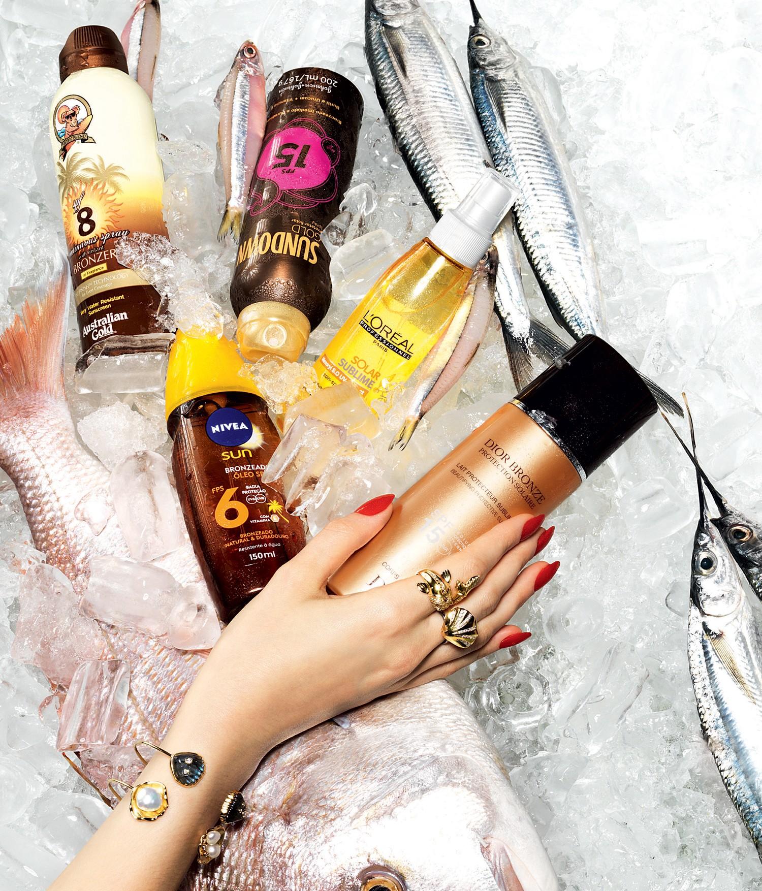 Continuous Spray with Instant Bronzer FPS 8, R$ 72, Australian Gold, Loção spray FPS 15, R$ 39, Sundown Gold, Solar Sublime Invisible Spray, R$ 95, L'Oréal Professionnel,  Bronzeador em óleo spray FPS, R$ 24, Nivea, Lait Protecteur Sublimant SPF 15, R$ 195, Dior Bronze (Foto: Marcel Valvassori)