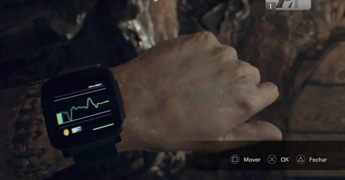 Pebble no pulso de Ethan em Resident Evil 7 (Foto: Reprodução/Felipe Vinha