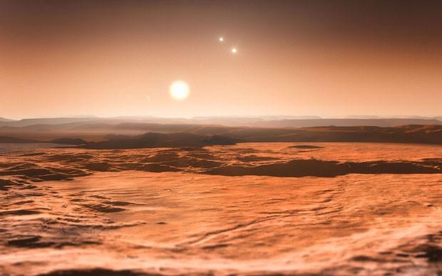 Impressão artística do sistema em torno da estrela Gliese 667 (Foto: Divulgação/ESO)