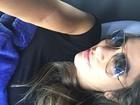 Grávida, ex-BBB Adriana viaja de ônibus: 'Por que não nasci rica?'