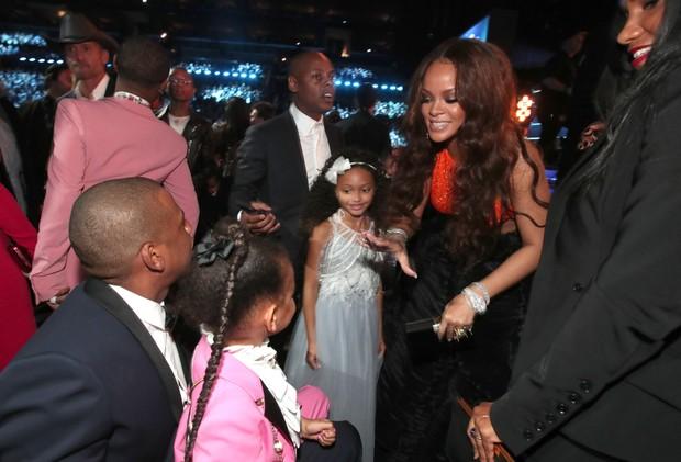 Jay-Z, Blue Ivy Carter e Rihanna (Foto: AFP)