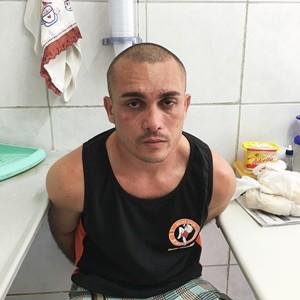 Vigilante, Flávio Barbosa Silva, de 36 anos, está preso (Foto: PM/Divulgação)