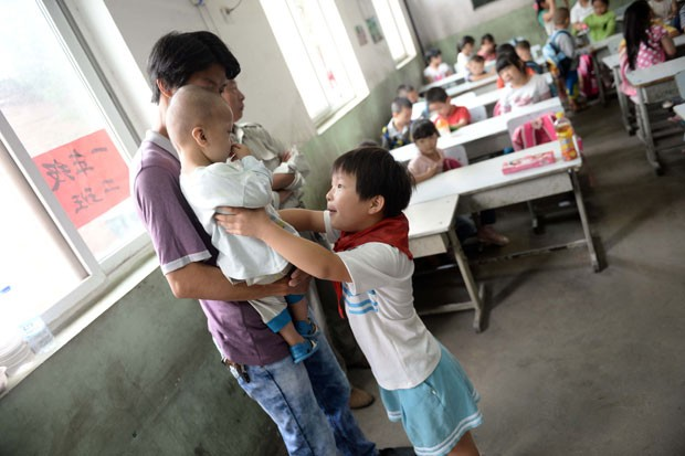 Pequim decidiu permitir a 20 mil casais da cidade ter segundo filho (Foto: AFP)