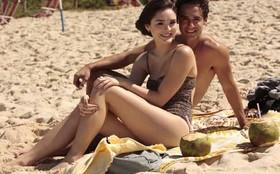 Isabelle Drummond medita em gravação na praia e usa modelo comportado