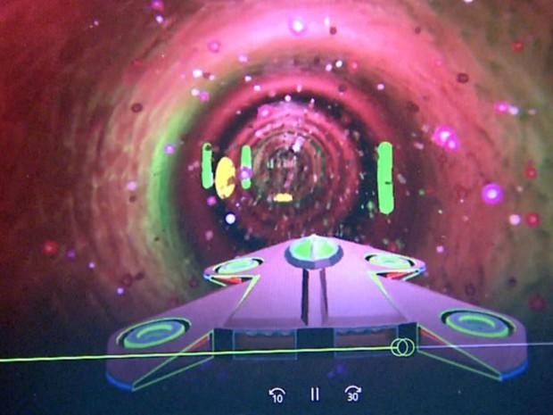 Imagem do jogo mostra nanodrone atingindo bactérias dentro do corpo humano (Foto: Reprodução/EPTV)
