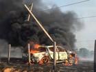 Caminhonete pega fogo após atingir poste de alta tensão em cidade de MT